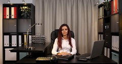 Business Person Female Hand Gestures Ok Sign Looking Camera in Office Interior Stock Footage