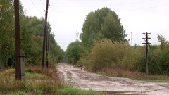 Country road in Russia rain mud clay rubber boots Stock Footage