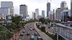 Traffic along main street in Jakarta business district Stock Footage