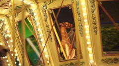 Carousel. Difficult to distinguish people ride the rides at night. Stock Footage
