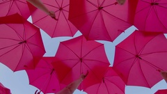 Pink umbrellas open in the sky as a decoration Stock Footage