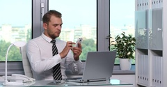 Business Male Browsing Mobile Phone Happy Smiling Surfing Internet Office Indoor Stock Footage
