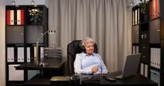 Older Pensioner Woman Listen Music Audio Book Using Headphones Laptop Computer Stock Footage
