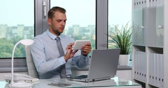 Confident Businessman Use Digital Tablet and Laptop Check Info Database Office Stock Footage