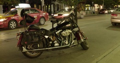 A lone motorcycle waits, parked downtown. Stock Footage