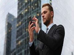 Corporate Businessperson Using Mobile Phone Working Online Front Office Building Stock Footage