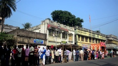 Pan shot of Indian people standing in Queue for money after demonetization. Stock Footage