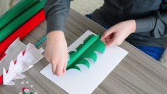 Teen Boy making Christmas card from color paper Stock Footage