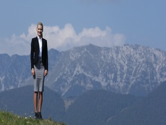 Caucasian Businesswoman Posing Smiling and Looking Camera in Beautiful Mountains Stock Footage