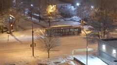 Aerial view of bus driving on cold blizzard snow winter night Stock Footage