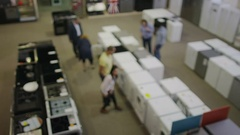 4K Customers shopping in a store selling kitchen appliances Stock Footage