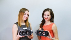 Young women with virtual reality headset or 3d glasses Stock Footage