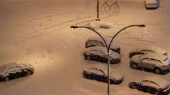 Aerial view of cars covered with snow on parking lot Stock Footage