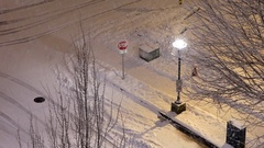 Aerial view of four way traffic intersection covered with snow on parking lot Stock Footage