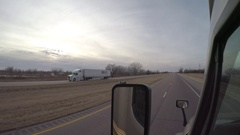Flat-Bed Semi-Truck Passing on the Left in Rural Nebraska Stock Footage
