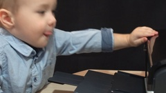 Little Boy Prints an Inkjet Printer Contract Stock Footage