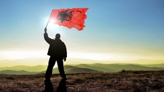 Successful silhouette man winner waving Albania flag Stock Footage