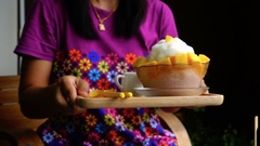 Slow motion of woman place tray dessert on table Stock Footage
