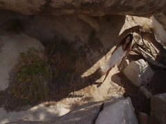 Girl walking in the desert through the rocks and caves. Mojave desert views Stock Footage