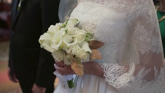Detail of bride's roses bouquet and hands holding Stock Footage