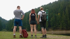 Group of tourist stand on the meadow Stock Footage