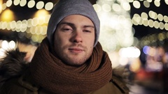 Happy man in hat and winter jacket at christmas Stock Footage