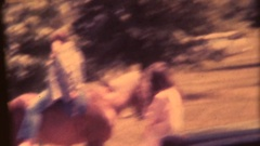 Vintage 8mm home movie, Teenage girls with horse Stock Footage