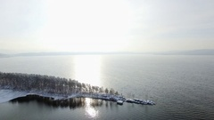 Aerial view of drone flying over lake and small island at winter Stock Footage