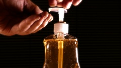 Hand wash being pumped from a bottle. Stock Footage