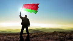 Successful silhouette man winner waving Belarus flag Stock Footage