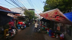 Closeup Camera Moves along Narrow Dirty Town Street in Morning Stock Footage