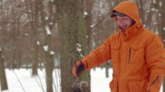 Man pays and have a fun with shepherd dog in snow winter park close-up Stock Footage