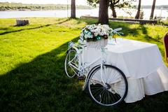 Flower decorated bicycle at wedding registration ceremony Stock Photos