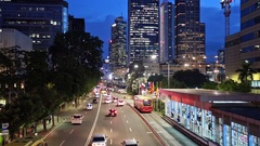 Night traffic in Jakarta business district in Indonesia capital city Stock Footage