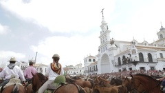 El ROCIO, ANDALUCIA, SPAIN - 26 JUNE 2016: horses in front of the church Stock Footage