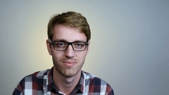 Young man in glasses Stock Footage