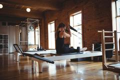 Woman practicing pilates in fitness studio Stock Photos