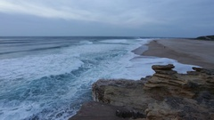After sunset, the waves on the beach in Nazare. Portugal Stock Footage