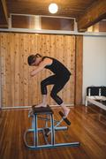 Woman practicing pilates in fitness studio Stock Photos