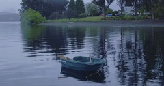 Aerial shot of lonely boat in the lake during rain Stock Footage