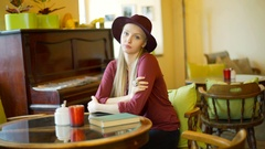 Beautiful woman in classic clothes doing morose look to the camera, steadycam  Stock Footage
