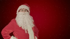 Happy Santa Claus with his woman helper reading Christmas letter or wish list on Stock Footage