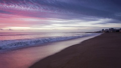 Magically pink sunset over the sea. Quarteira Algarve Stock Footage