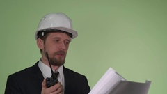 Engineer communicates by radio with the team Stock Footage