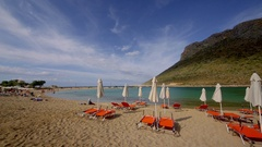 ORANGE SUN LOUNGERS STAVROS BEACH CRETE GREECE Stock Footage