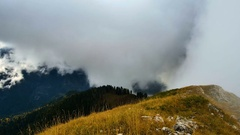 Timelapse of clouds rising up the mountains, colorful autumn landscape Stock Footage