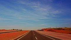 Motion along Asphalt Road to Infinity among Boundless Dunes Stock Footage
