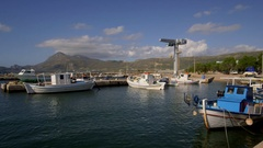 FISHING BOATS IN HARBOUR FALASARNA CRETE GREECE Stock Footage