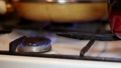 The pan is on the hob. The increased flow of gas. Stock Footage