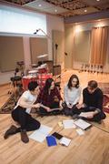 Team of musician composing tune in studio Stock Photos